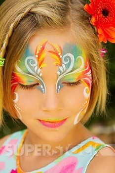 Hawaii, Young girl wearing colorful facepaint. | Stock Photo 1760-13941 : Superstock