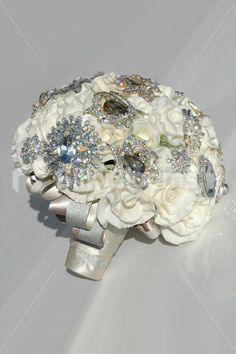 Large Ivory Real Touch Rose & Mocha Crystal Brooch Bridal Bouque Large Ivory Real Touch Rose & Mocha Crystal Brooch Bridal Bouqut [Heidi - Bride] - £399.99 : Artificial Wedding Flowers | Bridal Bouquets | Silk Wedding Flowers | Wedding Bouquets | Wedding Flowers, Silk Blooms Glasgow, we sell and hire artificial wedding flowers, bridal bouquets, buttonholes and wedding table arrangements.