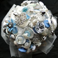 Interesting take on a bouquet...  Stunning white / blue button bouquet
