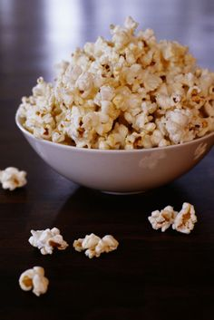 Popcorn - It's high-volume for relatively low-calories. Seriously, a three cup serving only packs about 150 calories.