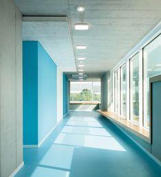 Great use of color blocking in interior paint schemes - Secondary School Ergolding by Behnisch Architekten