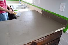after looking at the finished cement, i would definitely add some color/dye.  in some cases it may look fine as grey, but not most it think. From Young House Love, a faux cement countertop treatment that can be applied right over your laminate.  The tutorial gives you all the steps on how to use a product called Ardex with plenty of photos that show you the finished result.  Ardex-10-Spreading-First-Layer-younghouselove