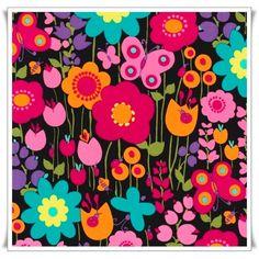 Flores de brillantes colores sobre fondo negro.