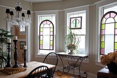 Mementos from travels abroad, like antique stained glass panes, are on display in this cultured cottage.