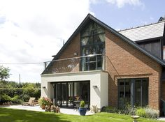 Stunning Bespoke Extension With Bifold Doors And Upper Floor Balcony Overlooking The Garden