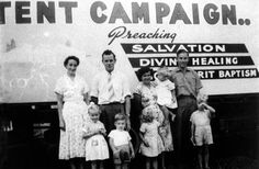 Pentecostal evangelists, from left Beryl and Rob Wheeler and Mavis and Ian Hunt, pose with their children outside the ex-army tent used from 1957 for their New Zealand-wide 'Word of Faith Ministry'. At times the tent was pitched directly opposite a church whose members they wished to convert. Rob Wheeler later became a leader in the New Life group of Pentecostal churches.