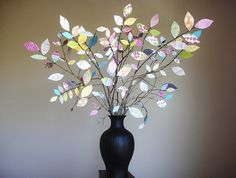 Such a cute idea! And it only takes some small branches, paper, and wire! #Vase #Tree #DIY #Crafts #Creative #HomeDecor