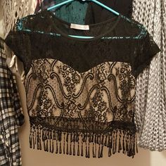 Lace crop top New never used. Has tan lining in front only to cover chest. Lace in back only.  Super cute Tops Crop Tops