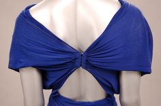 Madame Grès couture sapphire blue draped jersey `Goddess' gown, circa 1970, black on white 1 Rue de la Paix label, with cowl neck, drapes of fabric curve forwards at the waist and cascade into drapes held in a band at the centre front, naked triangular lower back section. Detail