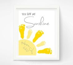 "A year-long project but very cute! ""You are my sunshine"" with footprints from newborn feet and then 1 year old feet to create the sunrays."