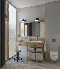 vanité salle bains en bois clair et appliques vintage scandinaves