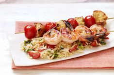 Shrimp Bruschetta with Orzo Pasta - Garlic, tomatoes, bread and olive oil combine to create a flavorful shrimp and orzo dish that will win rave reviews from your backyard BBQ crew.
