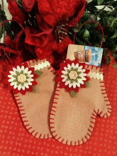 These pretty mitten ornaments/ gift holders are all hand stitched and have a red jute twine holder so it's ready to fill hand hang. Perfect size for gift cards.
