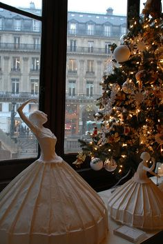 These graceful ballerinas dance under the Christmas tree of Palais Garnier's gift shop. From Paris and Beyond. blog  What a view of the icy street below.