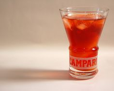 A classic Negroni, one part gin, one part sweet (red) vermouth, and one part Campari. The perfect apéritif.