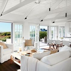 Take a look at some of our most coastal-chic living room transformations.To make this Nantucket cottage's small footprint feel larger and the ceilings seem higher, designer Stephen Theroux brightened … Cottage Living Rooms, Coastal Living Rooms, Chic Living Room, Cottage Interiors, Coastal Homes, Living Room Decor, Cottage House, Dining Room, Living Area