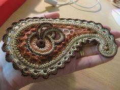 Not in English, but lots of pics showing beautiful crochet...and really mad skills with a crochet hook.