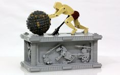 Kinetic LEGO sculpture of Sisyphus, endlessly pushing his boulder. Includes building instructions for the core model.
