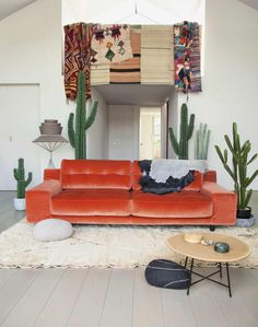 American West-themed Living Room with Orange Velvet Sofa