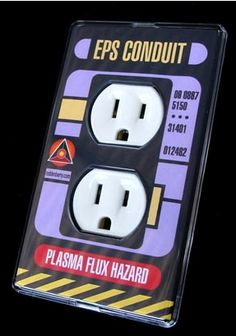 COOLNESS!  We would TOTALLY put these up all over our apartment :D  StarTrek Socket plate.