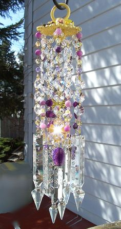 Jeweled Violets and Daffodils Antique Crystal Wind Chime. Sheri Thompson, via Etsy. b