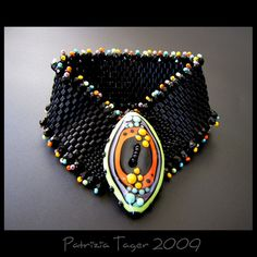 Beadygirl Beads lampwork button ....with peyote! Love!