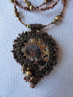 Ammonite necklace by iamcr8ve, via Flickr I bought 2 ammonites and knew I wanted to bead around them, but this gives me some ideas...