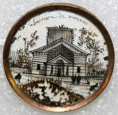 "¤ French painted button depicting a building and reading : ""Barricade de Vanves"" Date: ca. 1780 Culture: French Medium: glass. Credit Line: From the Hanna S. Kohn Collection, 1951 Accession Number: 50.231.209–.212"