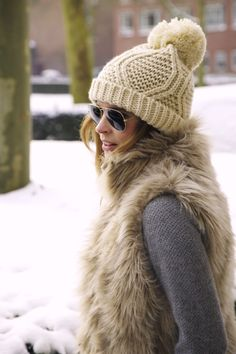Real or faux... fur is a must-have. #winter #winterfashion #fashion #style #vest cozy winter, snow bunni, winter style, winter outfits, winter fashion, knit hats, pom pom, winter chic, winter hats