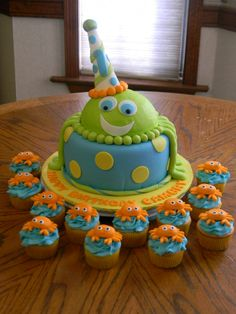 "Under the Sea 1st Birthday - 8"" cake, octopus legs in fondant, body of octopus is 6"" sports ball  half with buttercreme with 50/50 gumpaste fondant hat.  The body of the octopus was removed for the baby's smash cake.  Crabs on cupcakes are fondant.  I really enjoyed making this cake as it was such a cute theme. Change colors to pinks, purples, and blues"