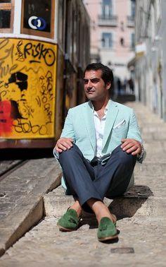 Shop this look on Lookastic:  http://lookastic.com/men/looks/blazer-long-sleeve-shirt-dress-pants-tassel-loafers-pocket-square/11421  — White Long Sleeve Shirt  — White Pocket Square  — Mint Seersucker Blazer  — Navy Dress Pants  — Dark Green Suede Tassel Loafers