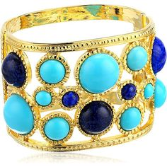 Kenneth Jay Lane Gold-Plated Colored Faux Gems Open Cuff Kenneth Jay Lane is an American costume jewelry designer. His fabulous costume jewelry has caught the eye of the worlds most glamorous women for over five decades including Jacqueline Kennedy Onassis Elizabeth Taylor Diana Vreeland Audrey Hepburn and Diana Princess of Wales. Glamorous and striking this colorful simulated gemstone cuff bracelet features turquoise-tone and lapis-tone cabochon that measures 2.45 inches diameter by 1.95…
