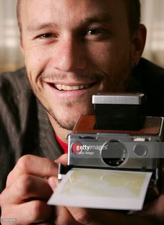 Actor Heath Ledger poses for a portrait, holding a camera, while promoting his film 'Brokeback Mountain' at the Toronto International Film Festival September 10, 2005 in Toronto, Canada.