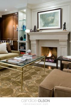 Fireplace Design Idea with Classic Elements • Bookcases with Mirror Backs and Glass Shelves • How to light a Fireplace Wall • Decorate with Gold and Silver Finishes • #candiceolson #candiceolsondesign Fireplace Wall, Fireplace Design, Candice Olson, Glass Shelves, Bookcases, Modern Decor, Wall Decor, Advice, Hairstyles