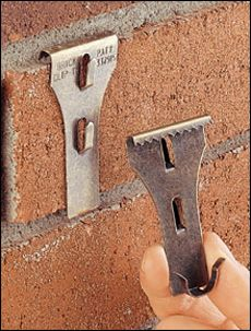 Brick Clip ($9 for 4): hang picture fames etc. on exposed brick without damaging the wall.