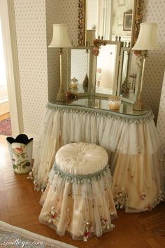 Could decorate old vanity with fabric, tulle and beaded border fabric