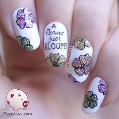 'A flower just blooms' glitter nail art #tutorial #whitepolish #piggieluv