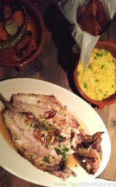 Txokos Basque Kitchen Pescado Xixario Wood Grilled Whole Fish With Garlic Chips