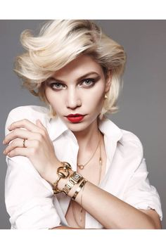 White shirt, gold jewelry, and red lips.