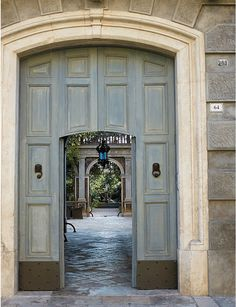love the door withing the larger gate. Good for North Entrance to Central Garden that studio and guest suites open onto.   Bernalda, Italy