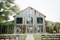 Beautiful bohemian wedding with bride and groom during at their ceremony at Vista West Ranch in Dripping Springs, Texas in the Hill Country.