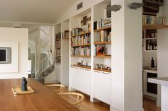 All white built-ins with wood shelves