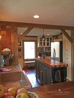 (KitchenT, pic 1 of 14) Using reclaimed wood from dismantled barns, our custom kitchen team handcrafted and installed the flooring, cabinetry, islands and barn beams at the entrance to the room. See us for reclaimed barn wood furniture for all rooms of the home, handcrafted in the heart of Amish country, Lancaster County, PA. Custom design is our specialty. © 2016 E. Braun Farm Tables and Furniture, Inc.™