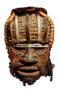 Africa | Mask from the Grebo people of Ivory Coast | Wood, cowrie shells, metal, teeth and natural fiber | 20th century
