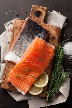 Raw salmon fish fillet by karandaev. Raw salmon fish fillet with spices cooking on cutting board. Top view - My Website 2020 Salmon Recipes, Raw Food Recipes, Fish Recipes, Seafood Recipes, Raw Photography, Food Photography Styling, Carnicerias Ideas, Raw Salmon, Salmon Dishes
