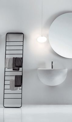 Bowl Art: white sink, huge round mirror and black towel rail - minimal design | bathroom . Bad . salle de bain | Design: Falper |