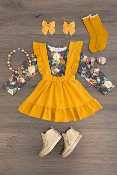 Your girl will fall in love with the simple and sleek style of this suede suspender skirt set. A long sleeve floral print top paired with a mustard suede suspender skirt with ruffle suspenders to complete the look. Baby Outfits, Little Girl Outfits, Toddler Outfits, Cute Outfits, Little Girl Skirts, Baby Girl Fashion, Toddler Fashion, Kids Fashion, Dresses Kids Girl