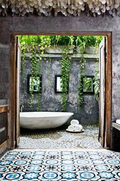 Outdoor baths are such a luxury, and teemed with rustic surfaces it creates that exotic feel we all crave!