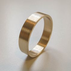 Handmade recycled eco-friendly solid 14k yellow gold wedding band - Satin finish - Modern Wedding Ring - Men's Wedding Band. $425.00, via Etsy.