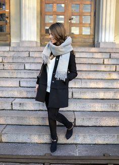 black jacket, grey scarf, white sweater